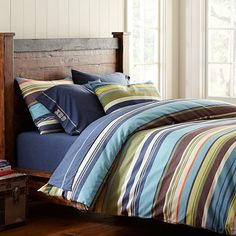 Shoreline Duvet on pottery barn teen. Also, like the bed and the wood boards on the wall.