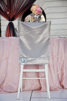 I do linens provided blush table linens and custom tailored chair covers for this photoshoot