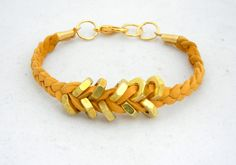 Mustard Yellow Suede Leather Hex Nut Bracelet. $12,00, via Etsy.