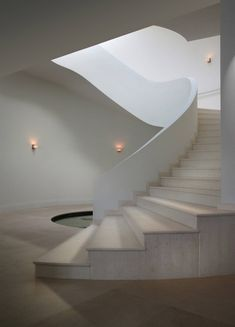 Beautiful modern villa with pool house built right on the coast of Miami Beach Island with gorgeous interior design. Modern Staircase, Staircase Design, Staircase Decoration, Concrete Staircase, White Staircase, Curved Staircase, Spiral Staircases, Minimalist Architecture, Interior Architecture