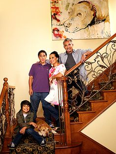 Cesar Millan Family Photo with Daddy Painting Hanging in the background