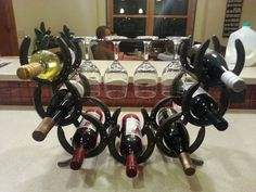 Horseshoe Wine rack holds 7 bottles and four glasses by Turpinshorseshoes