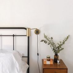 A little update on this side of our bed, sconce from my old room is finally up. // #rNgHOME