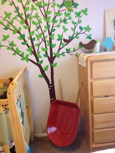I am going to have to paint a tree like this in my baby's room one day!