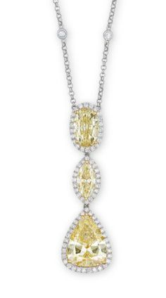 A COLOURED DIAMOND AND DIAMOND PENDENT NECKLACE The collet-set circular rose-cut diamond neckchain, suspending a pear-shaped yellow diamond, joined to an oval and marquise-cut yellow diamond, each within a brilliant-cut diamond surround, mounted in platinum and 18k yellow gold, 40.2 cm long