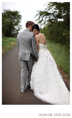 Looking back Wedding Photography Pose- Especially because the back of your dress is so stinking pretty!!!