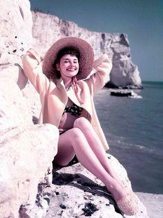 Audrey Hepburn, basking in the sun.