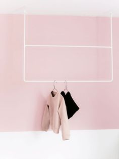 hanging rack with pink and black clothing. / sfgirlbybay