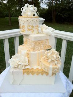 Ivory and Gold Cake Stacked Like Wrapped Packages With Bows and Flowers