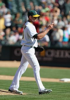 Grant Balfour #50 of the Oakland Athletics points to home plate after the third out is recorded and the Oakland Athletics beat the Boston Red Sox 6-2 at O.co Coliseum on September 2, 2012