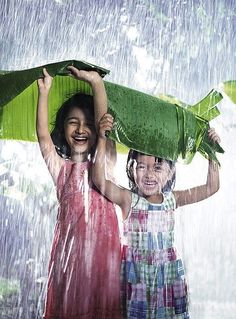 Many adults complain when it´s a rainy day, but the kids just love it. Get a hold of these amazing photography of the kids playing in rain. I Love Rain, No Rain, Girl In Rain, Rain Storm, Walking In The Rain, Singing In The Rain, Rain Photography, Happy People Photography, Village Photography