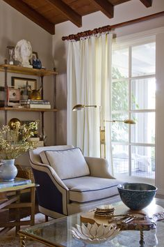 Vintage club chairs in a French Country meets glam home designed by Emily Hederson