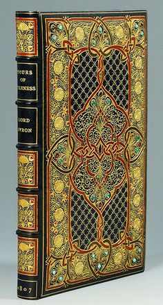 Lord Byron: Hours of Idleness (1807), first edition second issue, with early 20th century jewelled Cosway-style binding by Sangorski Sutcliffe. The interior contains miniature portraits of Lord Byron and his ancestral home, Newstead Abbey. Original silk and velvet lined leather bound case.