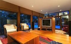 Interior and Exterior Design Home in Modern Sensation: Marvelous Family Room Design In House Designs Inside With Wooden Floor Wooden Table A. Twilight House, Twilight New Moon, Twilight Saga, Exterior Design, Interior And Exterior, Glass House Design, Family Room Design, My Dream Home, Dream Homes