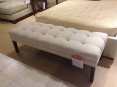 upholstered bench for foot of bed in master BR