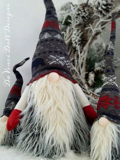 Original Nordic Gnomes by DaVinciDoll Designs©  DaVinciDollDesigns Christmas Collection Swedish Norwegian Tomte Nisse Gnome features weighted bottom for extra stability. Bendable arms and bendable grey hat with red, white, navy blue designs of snowflakes, trees, and Nordic X-mas