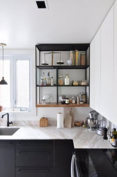 Folks with sleek cabinets inside also understand the power of the outside of their cabinets, harnessing that space for stylish display and storage in a way that adds to the function and feel of the room. Hooks underneath cabinets, baskets on top, storage screwed into the sides, open shelving installing beside closed…don't just think of your cabinets from the inside.
