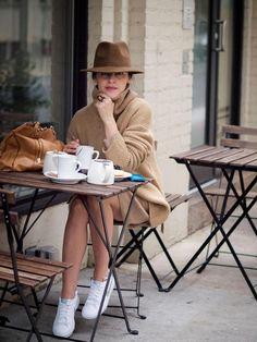 camel outfit with fedora hat and canvas sneakers