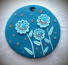 Polymer clay pendant, handmade with applique technique, one of a kind. Rich turquoise with light turquoise and light brown flowers and light brown dots. By Lis Shteindel.