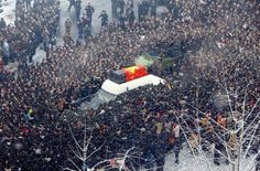 A car carries a portrait of Kim Jong Il during the funeral procession in Pyongyang, North Korea, on Dec. 28.