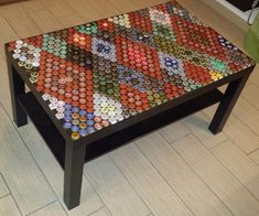 The table top is made by 687 caps, from beers of all over the Europe, submerged with transparent epoxy resin.The top surface is like glass, but you can see the caps trapped in.