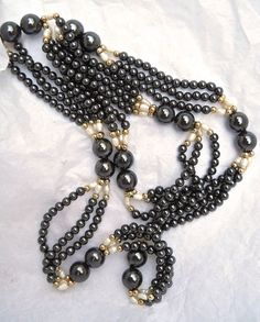 A genuine hematite necklace with fresh water pearls in a triple strand....vintage:  Cold to the touch and lovely to wear is this genuine hematite necklace, and adorned with...