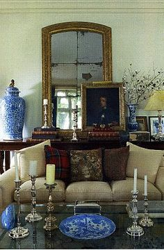 Ralph Lauren Home.  Blue and white ceramics with plaid.  I like the weathered mirror for the rustic touch.