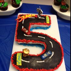 Number 5 race car cake & cars 2 race track cupcakes made with my sister-in-law. First time carving a cake & using fondant - proved a little more challenging than anticipated. But we still had a lot of fun & the birthday boy loved it.