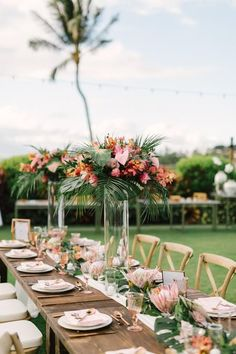 Home Was The Perfect Destination For These Hawaii Natives [ Tall tropical centerpieces with pink florals and lush greenery for a Hawaii wedding. wedding centerpieces Home Was The Perfect Destination For These Hawaii Natives Table Decoration Wedding, Tropical Wedding Centerpieces, Tropical Wedding Decor, Wedding Table, Floral Wedding, Tropical Weddings, Hawaiian Centerpieces, Tropical Wedding Bouquets, Tropical Flower Arrangements
