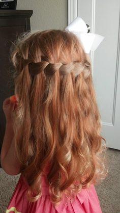Waterfall braid on toddler...didn't think it would work as well with her curls but they made it that much cuter!