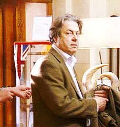 """This is from """"The Thick of It"""". At Stewart's seminar, and he says, """"Okay, people. Abandon phones, all ye who enter here."""" Peter's bitch face is priceless. Roger Allam, Cabin Pressure, Yellow Car, Phones, Actors, Funny, Face, People, Movies"""