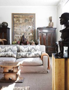 Ethnic Eclectic~aphrochic.com~The most amazing interiors have a mix of influences. In this modern home in Johannesburg a collection of Asian, Indian, European and African art all come together beautifully. The combination of gl...