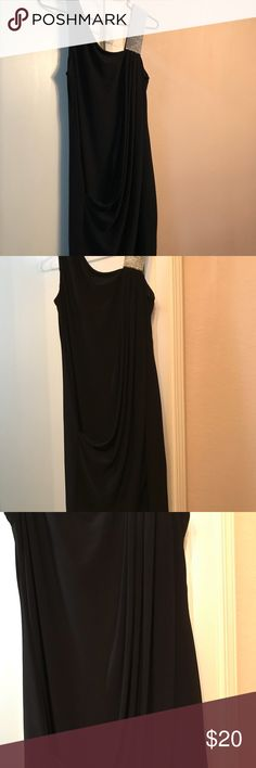 """Black party dress Flattering size 8 black cocktail dress. Worn once a couple of years ago for NYE.  Lots of compliments on this dress! Hits about 2"""" above the knee.  Dress has a flattering draping rouche across the front.  Rhinestone shoulder on one side. Dresses Mini"""