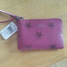 Nwt berry pink coach wristlet This wristlet is so cute!  It was bought from coach, it's authentic!  Make an offer since I can't get back to the coach store anytime soon! Coach Bags Clutches & Wristlets