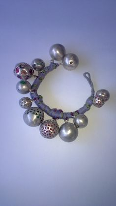 Silver bracelet with silk fabric by Maria Vasiliou from Maria Vasiliou Kosmima..