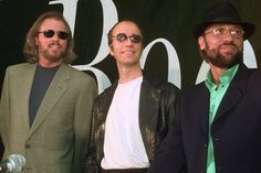 FILE - This July 29, 1998 file photo shows brothers Barry, Robin and Maurice Gibb, left to right, of the pop group the Bee Gees during a news conference in Miami Beach, Fla. The Recording Academy and CBS will pay tribute to the Bee Gees two days after the Grammys with a concert featuring a range of artists, including Celine Dion, Andra Day, John Legend and Keith Urban. The concert will be taped Feb. 14 at the Microsoft Theater, to be broadcast on CBS later this year. (AP Photo/Marta…
