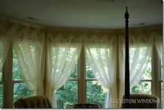 Creative way to hang curtains in a bay window