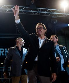 President of Catalonia Artur Mas waves to wellwishers after the Catalanist coalition 'Junts pel Si' (Together for the Yes) claimed victory in the regional elections held in Catalonia on September 27, 2015 in Barcelona, Catalonia. The main Catalanist parties, Catalan Democratic Convergence 'Convergencia Democratica de Catalunya' party (CDC), Republican Leftist of Catalonia 'Esquerra Republicana de Catalunya' party (ERC) and a group of social associations have joined together.