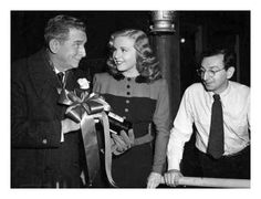 Deanna Durbin with Edward Everett Horton and Charles David (Director) on the set of LADY ON A TRAIN