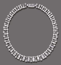 A DIAMOND NECKLACE   Of flexible design, composed of a series of alternating baguette and circular-cut diamonds, suspending a graduated square or baguette-cut diamond fringe, terminating in a baguette or circular-cut diamond, joined by a triple rectangular-cut diamond Bulgari clasp, trimmed by circular-cut diamonds, mounted in platinum and 18k gold, 16¼ ins. in a green leather case  Clasp signed Bulgari