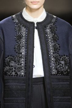 Valentino 2012- half Yo-Yos with simple embroidery. Great embellishments for a simple black jacket.
