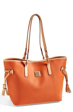 Free shipping and returns on Dooney & Bourke Coated Canvas Tote at Nordstrom.com. A logo-etched plate and smooth contrast trim lend signature refinement to a versatile cotton-canvas tote that easily stashes all your essentials and then some.