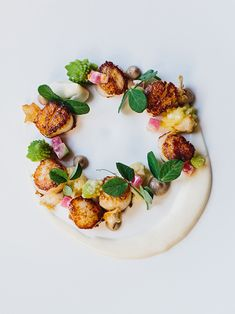 Roasted Nantucket Bay scallops ŵ cauliflower + black truffle purées, cauliflower + romesco stem chips (recipe) // Seafood course | Chef David Andrew Carson of Bacchanalia // via The Art of Plating