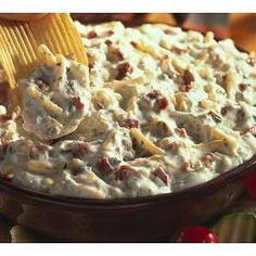 Bacon & Cheddar Dip 1 1-ounce packet Hidden Valley® Original Ranch® Dips Mix 1 16-ounce container sour cream (or Greek yogurt even better!) 1 cup shredded cheddar cheese 4 stripsthick cut bacon, cooked, crisp and crumbled directions: 1. In a bowl, combine the dips mix and the sour cream and stir until well blended. 2. Fold in the bacon and cheese. 3. Chill covered for 1 hour.