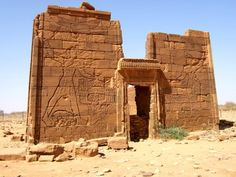 leradr:  The Temple of the Lion God Apedemak at Naga (to the east of the 6th cataract of the Nile), Meroë:on the Pylon are represented King NatakAmani (on the left, holding a lance) and Kandake/Queen Amanitore (on the right, holding a blade) smiting and killing captured rebels against Maat (the enemies of the Gods); above the King is represented Horus in His form of Falcon, and above the Queen there is Nekhbet in Her form of Vulture.On the Entrance-Gate is represented the Winged Solar Orb…