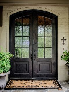 Amazing Home With Double Front Doors: Dark Traditional Double Front Doors Framed With Creamy Brick Wall ~ lcevans.com Classic Home Designs Inspiration