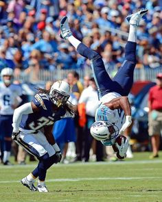 Tennessee Titans wide receiver Kenny Britt (18) flips upside down after making a catch as he is defended by San Diego Chargers defensive back Jahleel Addae