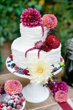 buttercream wedding cake with burgundy dahlias