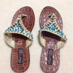 ✂️Last Call✂️Red Kiss Size 7 Sandals 🎉🎉HP🎉🎉 Teal , bronze, and gold colored flip flops. Was a display model when purchased. Worn less than 10 times. Still has a lot of life left in them. Red kiss Shoes Sandals