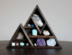 To make a larger one of this and have it cover the wall, and include plants and air plants. Then also have candles behind the geodes for ambient lighting when entering the space